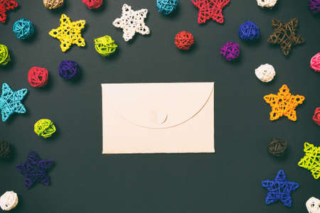 Top view of craft envelope, holiday toys and decorations on blue Christmas background. New Year time concept.