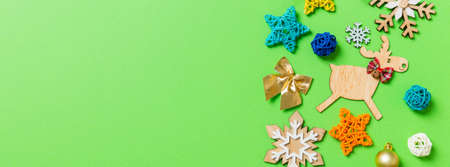 Top view Banner of green background with New Year toys and decorations. Christmas time concept with copy space.