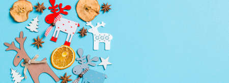 Top view Banner of holiday decorations and toys on blue background. Christmas ornament concept with empty space for your design. Stok Fotoğraf