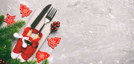 Top view Banner of festive cutlery on new year cement background. Christmas decorations with empty space for your design. Holiday dinner concept.