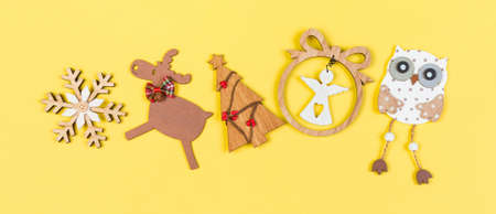 Top view Banner Christmas toys and decorations on colorful background. New Year holiday concept with copy space.