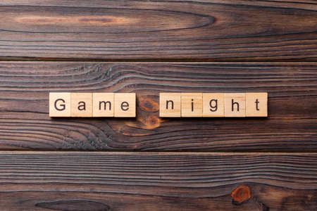 Game Night word written on wood block. Game Night text on wooden table for your desing, concept.