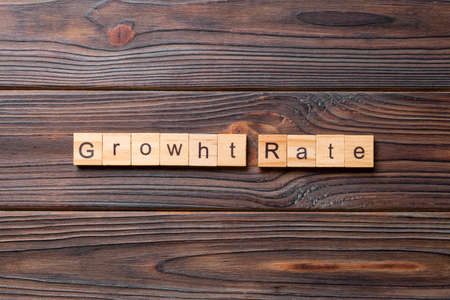 growth rate word written on wood block. growth rate text on cement table