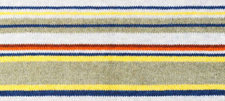 Closeup of colored knitted wool texture. Fabric multicolor background.