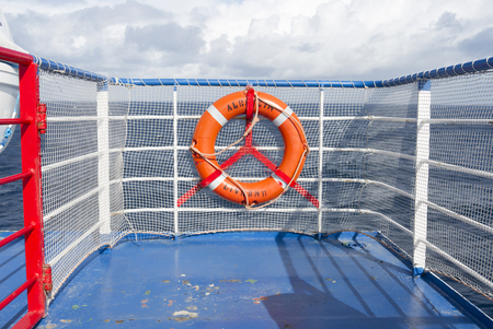 life belt: Life belt fixed on a ship railing  in the middle of the Atlantic Ocean. Stock Photo