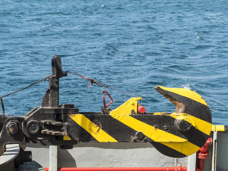 wrack: Yellow and black striped hook on a tugboat in harbor. Stock Photo