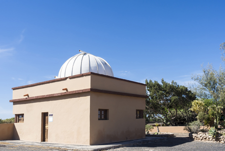 meteorites: Dome of a public observatory on Canary Islands against deep blue sky.