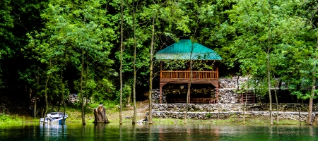 Another photo of a small wooden house on the Lake Matka in Skopje photo