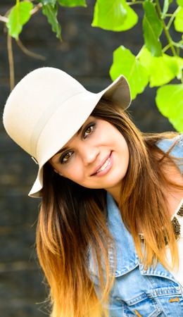 a young woman is smiling  photo