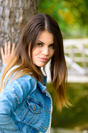 a young woman wearing jeans looking upset  photo