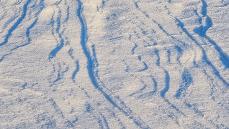 drifts: Snow drifts pattern. Abstract natural pattern of snow dunes at sunset Stock Photo