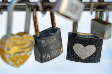 affixed: Wedding locks. Bunch of padlocks with inscriptions and ornaments.