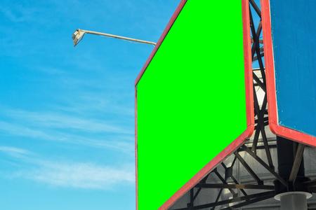 customizable: Blank billboard with Chroma key against blue sky. Red frame billboard