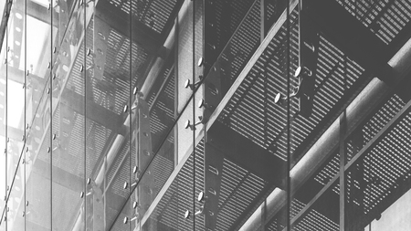 triplex: Black and white architecture abstract background. Glass curtain walls. Fasteners elements of spider glass system. Facade detail Stock Photo
