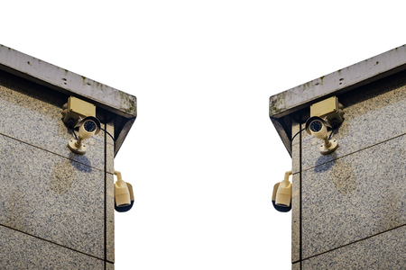 closed circuit television: Security cameras on the side of an modern building isolated on white background