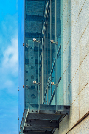 triplex: Glass curtain walls.Fasteners Elements of spider glass system. Facade detail