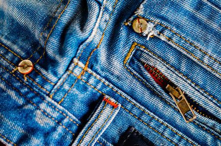 Detail of jeans trousers close-up. Pockets, pants, belt loops, thick stitches. Elements of denim pants background Stock Photo