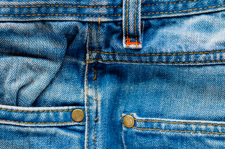 torn metal: Detail of jeans trousers close-up. Pockets, pants, belt loops, thick stitches. Elements of denim pants background Stock Photo