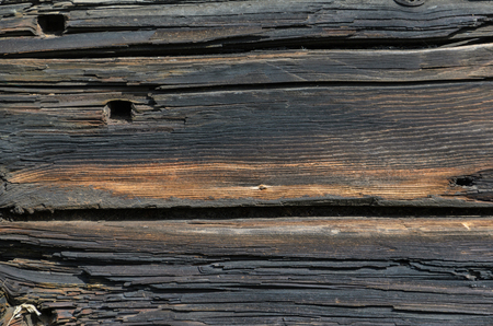Grey Old Log Cabin Wall Texture. Dark Rustic House Log Wall. Horizontal Timbered Background. Stock Photo