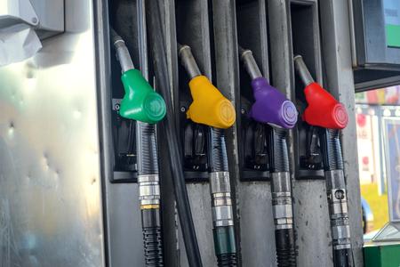 fuelling pump: Gasoline column for refueling. Four gasoline pump nozzles at petrol station
