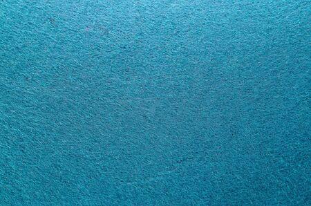 Blauwe kleur voelde textuur achtergrond. Vezeltextuur van gevoelde close-up