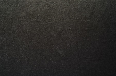 Black graphite texture of cardboard. Rough surface for background