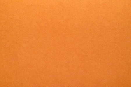 Bright orange texture of cardboard. Rough surface for background