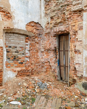 The facade of the old brick building collapses time and weather Stock Photo