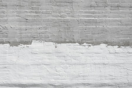 plaster wall: Thin layer of plaster on a brick wall. White and gray plaster wall texture. Empty background Stock Photo