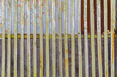 drywood: Old fence background. Wooden boards and rusty steel sheets Stock Photo