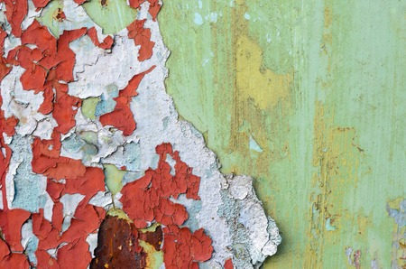 Green and red flaking paint on on old metal surface. Old metal texture for background Stock Photo