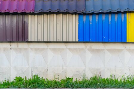 sheet metal: The Colorful galvanized sheet on concrete wall