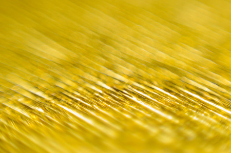 Gold Texture of Embossed Paper. Gold Paper Texture Background. Macro. Shallow depth of field. Abstract background with deep grooves in the texture of corrugated paper Stock Photo