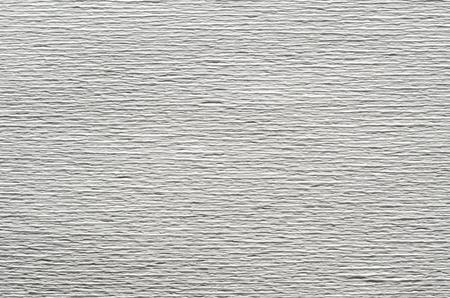 Texture blanche de papier gaufré. Abstrait avec des rainures profondes dans la texture du papier ondulé. Modèle de rainures horizontales Banque d'images - 80679167