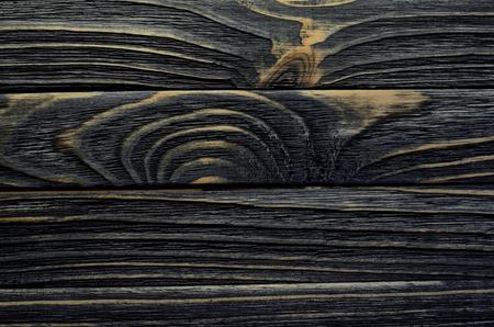 weatherworn: Old, Weather-worn Wood Board with Grains and Gnarls. Dark Wood Texture Close-Up