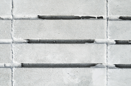 grooves: Concrete Tiles for Paving and Finishing with Parallel Grooves. Texture of building material