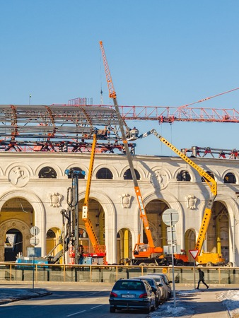 Belarus, Minsk - February 2, 2017: Football stadium Dynamo during the reconstruction. Installers in the lift fix elements of the structural elements of the roof.