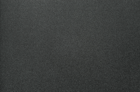 Grainy Texture of Black Plastic for Office Folders. Black Grainy Plastic Background Close-Up