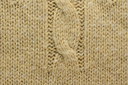 Knit Texture Of Beige Wool Knitted Sweater With Cable Knits Pattern