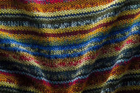 Colorful Knit Fabric Texture. Folds on of Knitted Sweater Cloth. Blank Background