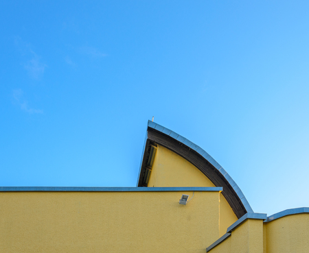 Element of the original building against a clear blue sky. Architectural background