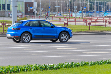 Minsk, Belarus - April 18, 2017: Blue Color Porsche Macan Stands at the Empty Crossroads in the City