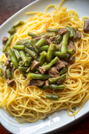 Plate with Hot Delicious Pasta with Meat and Green Beans, Top View