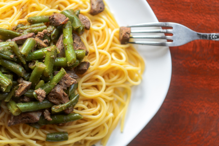 White Plate with Delicious Pasta with Meat and Green Beans, View From Above