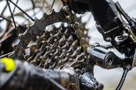 Mountain Bike Transmission in Mud. Dirty Chain Drive of Mountain Bike After Riding in Bad Weather