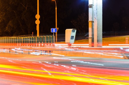Stationary Car Speed Radar Near a Highway Road. Night Road Traffic Background