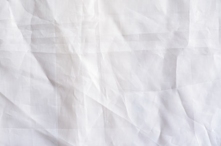 White Synthetic Lining Fabric with Folds. Crumpled Sheet or Clothes Background,