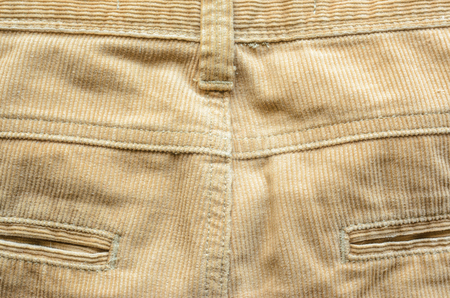 Textile Fabric of Corduroy Pants as Background. Pocket in Pants Closeup. Texture of Beige Velvet Clothes.
