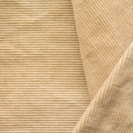 Texture of Beige Velvet Clothes. Geometric Pattern Neatly Stacked Textile Fabric of Corduroy as Blank Background for Your Design