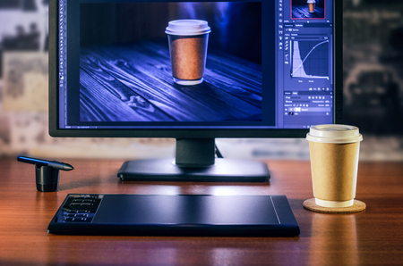 Desktop front view. Computer Graphics Tablet Cup of coffee Hand. Concept for website banner, mockup, background, presentation and marketing material
